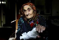 <p>Kesi Karuyeva, whose official documents showed she is the oldest person in the world, looks on inside her house in the village of Goity, about 20 km (12 miles) south of the Chechen capital Grozny September 27, 2011. REUTERS/Diana Markosian</p>
