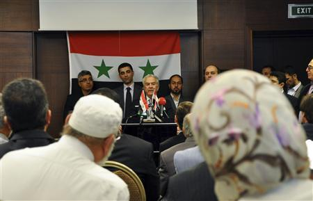 Syrian opposition figure Samir Nashar (C) addresses a meeting in Istanbul October 2, 2011. REUTERS/Stringer
