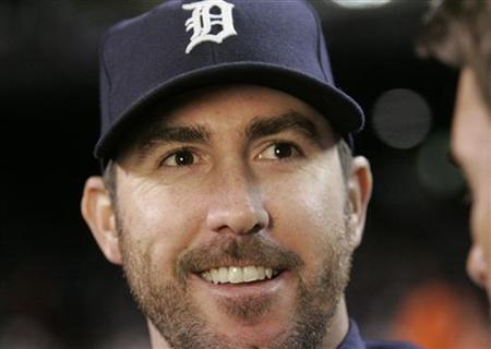 Detroit Tigers starting pitcher Justin Verlander smiles after the Tigers defeated the New York Yankees in Game 3 in their MLB American League Division Series baseball playoffs in Detroit, Michigan, October 3, 2011. REUTERS/Rebecca Cook
