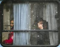 <p>An Iranian man speaks on his mobile phone as he sits in a bus during a snowy day in northern Tehran January 9, 2011. REUTERS/Morteza Nikoubazl</p>