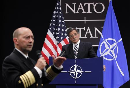NATO Supreme Allied Commander Europe (SACEUR) U.S. Navy Admiral James Stavridis (L) speaks next to U.S. Secretary of Defense Leon Panetta as they address a news conference during a NATO defence ministers meeting at the Alliance headquarters in Brussels October 6, 2011. REUTERS/Francois Lenoir