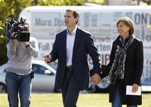 <p>Ontario Premier and Liberal leader Dalton McGuinty and his wife Terri arrive at a polling station in Ottawa October 6, 2011. Ontario voters will head to the polls today in a provincial election. REUTERS/Chris Wattie</p>