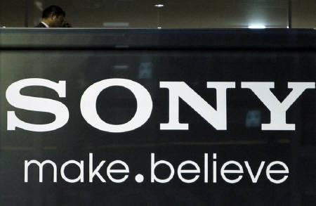 A man walks past a Sony Corp's logo at the company headquarters in Tokyo November 25, 2010. Sony Corp is nearing a deal to buy Telefon AB LM Ericsson's stake in their 50:50 smartphone joint venture, The Wall Street Journal reported on Thursday, citing people familiar with the matter. REUTERS/Toru Hanai