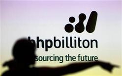<p>A woman gestures in front of a BHP Billiton sign during a half-year results briefing by the company's Chief Executive Marius Kloppers, in central Sydney February 16, 2011. REUTERS/Tim Wimborne</p>