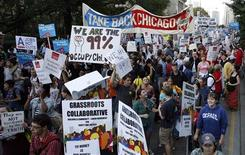 "<p>Members of a coalition called ""Stand up Chicago"" march during a protest down Michigan Ave in Chicago October 10, 2011. Mounting anger over joblessness and income inequality snarled rush-hour traffic in downtown Chicago as hundreds of teachers, religious leaders, union workers and other protesters marched on Monday on Michigan Avenue and gathered outside the Chicago Art Institute where a U.S. futures industry trade group was holding an evening cocktail reception. Five separate ""feeder marches"" -- which converged into one giant march up Michigan Ave -- were inspired by, but not formally affiliated with, the Occupy Wall Street movement that began in New York last month. REUTERS/Frank Polich - Tags: BUSINESS CIVIL UNREST POLITICS)</p>"