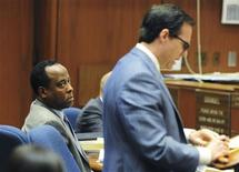 <p>Dr. Conrad Murray listens as his attorney Ed Chernoff question a witness in his trial in the death of pop star Michael Jackson in Los Angeles October 11, 2011 . REUTERS/Robyn Beck/Pool</p>
