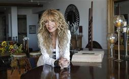 "<p>Actress Dyan Cannon poses for a portrait at her home in West Hollywood, California October 12, 2011. It was a fairy tale romance that turned in to a stormy marriage, and now Dyan Cannon has chronicled her relationship with Hollywood legend Cary Grant in her new book, ""Dear Cary: My Life with Cary Grant."" With an age difference of over 30 years, the duo had a magical courtship in the 1960s that eventually gave way to the dark side of Grant after they were engaged. Following three years of marriage and not long after the birth of their daughter Jennifer, the couple divorced and Cannon suffered a nervous breakdown. REUTERS/Mario Anzuoni</p>"