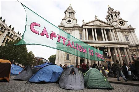 Demonstrators camp outside St Paul's Cathedral in central London October 16, 2011. Around 250 protesters set up camp outside St Paul's Cathedral in the heart of London on Sunday, promising to occupy the site indefinitely to show their anger at bankers and politicians over the global economic crisis. REUTERS/Olivia Harris