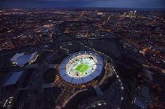 <p>The Olympic Stadium with the figure 1 mown into the grass to mark one year to go until the start of the London 2012 Olympic Games, is seen in this undated aerial photograph released in London on July 27, 2011. REUTERS/LOCOG/Handout</p>