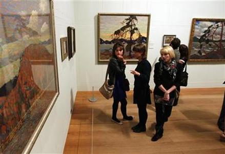 Guests view paintings by Canadian artist Tom Thomson during the show's opening at the Dulwich Picture Gallery in London October 17, 2011. REUTERS/Chris Helgren
