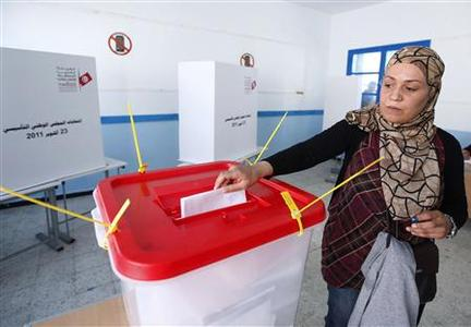A Tunisian woman casts her vote at a polling station in Tunis October 23, 2011. REUTERS/Anis Mili