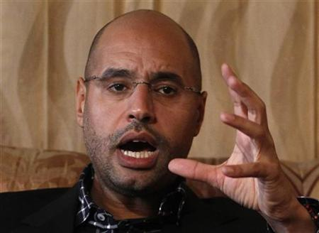 Libyan leader Muammar Gaddafi's most prominent son, Saif al-Islam, speaks during an interview with Reuters in Tripoli March 10, 2011. Picture taken March 10, 2011. REUTERS/Chris Helgren