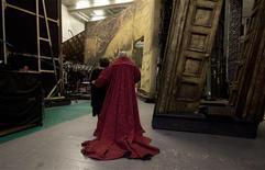 <p>Placido Domingo leaves the stage with his wife after the curtain call of Placido Domingo Celebration at the Royal Opera House after a special performance to celebrate his 40th anniversary with the Royal Opera in London October 27, 2011. REUTERS/Olivia Harris</p>