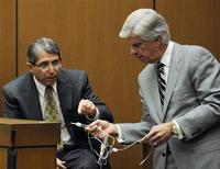 <p>Defense Attorney J. Michael Flanagan and defense witness Dr. Paul White (L) look at evidence during a redirect examination at the final stage of Conrad Murray's defense during his involuntary manslaughter trial in the death of singer Michael Jackson at the Los Angeles Superior Court in California October 31, 2011. REUTERS/Kevork Djansezian/Pool</p>