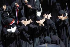 <p>Anti-government protesters shout slogans demanding the ouster of Yemen's President Ali Abdullah Saleh during a sit in calling to take Saleh to International Criminal Tribunal in Sanaa November 2, 2011. REUTERS/Louafi larbi</p>