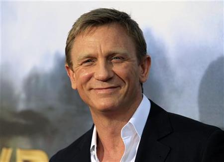 Actor Daniel Craig arrives for the world premiere of Universal Pictures motion picture ''Cowboys & Aliens'' in conjunction with Comic Con in San Diego, California July 23, 2011. REUTERS/Mike Blake