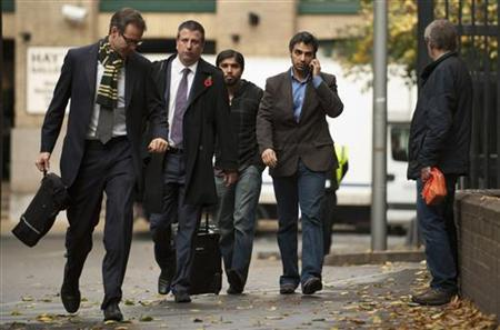 Former Pakistan cricket captain Salman Butt (second R) speaks on the phone as he arrives at Southwark Crown court for sentencing, after being found guilty of conspiracy to cheat and of conspiring to accept corrupt payments, in London November 3, 2011. REUTERS/Philip Brown