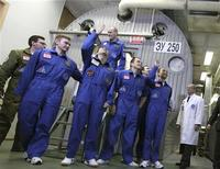 <p>Mars500 experiment crew members react after leaving the mock spaceship in Moscow November 4, 2011. REUTERS/IBMP/Oleg Voloshin/Handout</p>