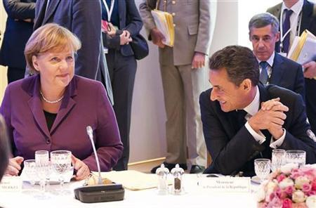 France's President Nicolas Sarkozy and Germany's Chancellor Angela Merkel meet with Greece's Prime Minister George Papandreou (not seen) for crisis talks before a G20 summit of major world economies in Cannes, November 2, 2011. REUTERS/Bundesregierung/Guido Bergmann