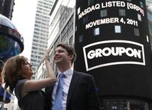 <p>Groupon Chief Executive Andrew Mason poses with his newly married wife, pop musician Jenny Gillespie, outside the Nasdaq Market following his company's IPO in New York November 4, 2011. REUTERS/Brendan McDermid</p>