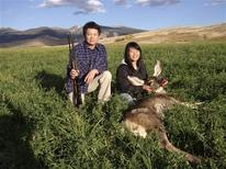 <p>Hunter Anna Yu poses with her father George and the deer she shot in Idaho in this October 31, 2011 photo released to Reuters, November 7, 2011. Reuters/George Yu/Handout</p>