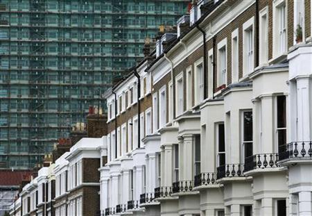 A row of terraced houses are seen below an apartment block in London August 30, 2011. REUTERS/Luke MacGregor