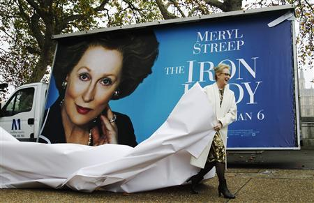 Actress Meryl Streep unveils a poster for her new film ''The Iron Lady'' opposite the Housese of Parliament in central London November 14, 2011. REUTERS/Luke MacGregor