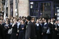 <p>An ultra-Orthodox Jewish man walks past schoolgirls in Jerusalem's Mea Shearim neighbourhood November 8, 2011. REUTERS/Baz Ratner</p>