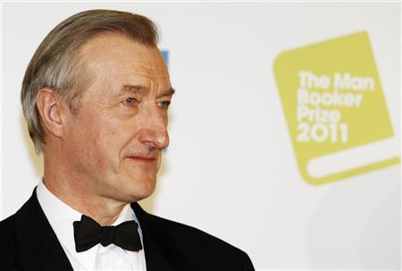 Julian Barnes poses after winning the 2011 Man Booker Prize for Fiction with his book ''The Sense of an Ending'' at the Guildhall in London October 18, 2011. REUTERS/Luke MacGregor