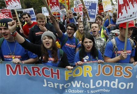 Demonstrators protest against job cuts in central London November 5, 2011. REUTERS/Luke MacGregor