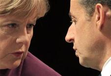 <p>France's President Nicolas Sarkozy (R) and Germany's Chancellor Angela Merkel exchange words as they attend a joint press conference after crisis talks with Greece's Prime Minister on the eve of a G20 summit of major world economies in Cannes, November 2, 2011. REUTERS/Charles Platiau</p>