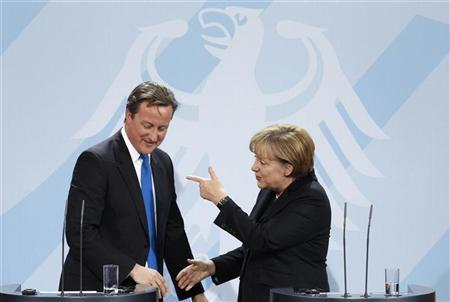German Chancellor Angela Merkel (R) chats with Britain's Prime Minister David Cameron during a news conference after talks in Berlin November 18, 2011. REUTERS/Tobias Schwarz