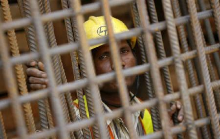 A worker is seen at a construction site in New Delhi June 17, 2009.   REUTERS/Adnan Abidi/Files