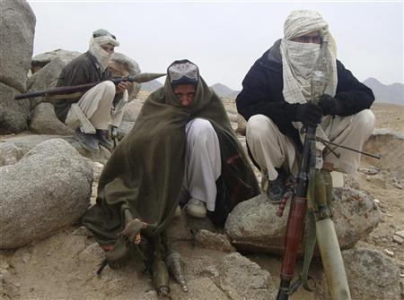 Taliban fighters pose with weapons in an undisclosed location in Afghanistan October 30, 2009. REUTERS/Stringer