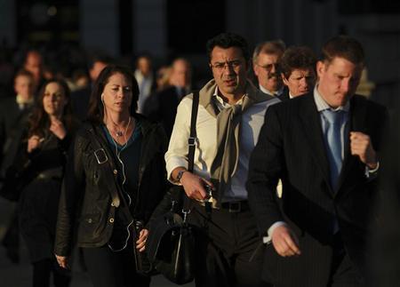 City workers cross London Bridge in London's financial district, October 7, 2011 REUTERS/Olivia Harris