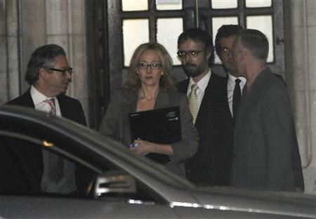 Author J.K Rowling (C) leaves the Leveson Inquiry at the High Court in central London, November 24, 2011. REUTERS/Paul Hackett