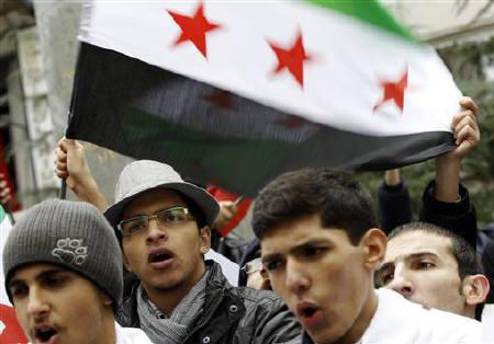 Syrians living in Turkey shout slogans as they protest against the government of Syria's President Bashar al-Assad after Friday prayers in front of the Syrian consulate in Istanbul November 25, 2011. REUTERS/Murad Sezer