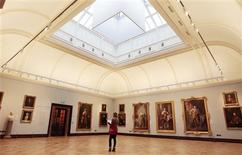 <p>A woman looks at the artwork on display in the Ramsay Room, during a special viewing of the Scottish National Portrait Gallery in Edinburgh, Scotland November 28, 2011. REUTERS/David Moir</p>