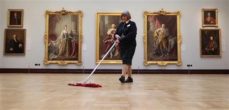 Gallery assistant Heather Bundy sweeps the floor of the Jacobite Room during a special viewing of the Scottish National Portrait Gallery in Edinburgh, Scotland November 28, 2011. The gallery is to open this Thursday after a two and a half year year 17.6 million pounds restoration project which has increased its overall space by sixty percent. REUTERS/David Moir