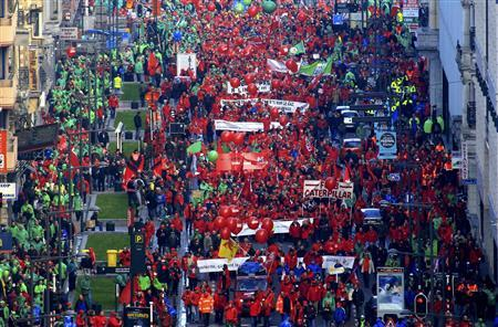 Protesters carry placards as they march through central Brussels December 2, 2011. REUTERS/Yves Herman