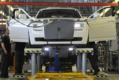 Employees work in the finishing and testing areas at the Rolls-Royce plant where the Phantom and Ghost models are manufactured in Goodwood, near Chichester in this May 10, 2011 file photo. REUTERS/Toby Melville