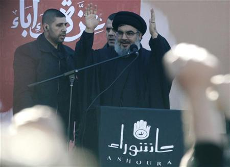 Lebanon's Hezbollah leader Sayyed Hassan Nasrallah greets his supporters during a Muharram procession to mark Ashura in Beirut's suburbs, December 6, 2011. REUTERS/ Sharif Karim