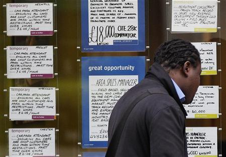 A man looks at job advertisements in the window of a recruitment agency in Liverpool November 16, 2011. REUTERS/Phil Noble