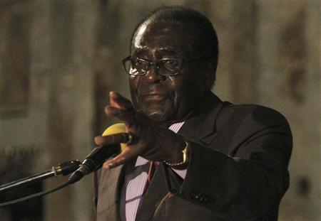 Zimbabwe's President Robert Mugabe addresses a joint meeting of senior members of his Zanu PF and the opposition MDC party of Prime Minister Morgan Tsvangirai to discuss political violence, in Harare November 11, 2011. REUTERS/Philimon Bulawayo