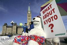 <p>A Greenpeace activist dressed in a polar bear costume demonstrates in front of Parliament Hill to call on Canada's minority Conservative government to meet its commitments under the Kyoto Protocol, in Ottawa January 29, 2007. REUTERS/Chris Wattie</p>