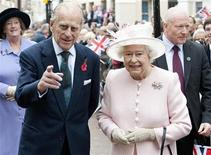 <p>Britain's Queen Elizabeth and Prince Phillip walks through the old town during a visit to Margate, in Kent, southern England, November 11, 2011. REUTERS/Pool/Eddie Mulholland</p>