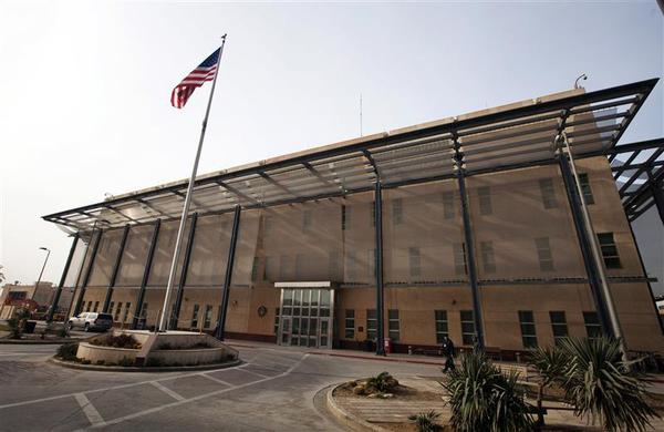 A U.S. flag flies in front of the Chancellery building inside the compound of the U.S. embassy in Baghdad December 14, 2011. REUTERS-Lucas Jackson