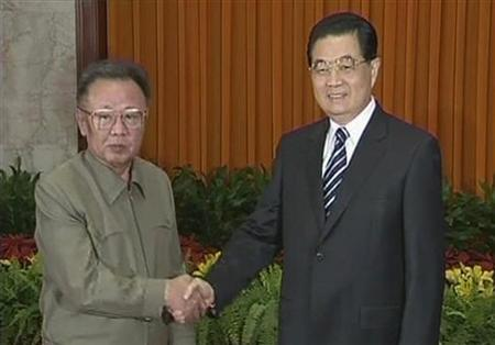 China's President Hu Jintao (R) and North Korean leader Kim Jong-il shake hands at the Great Hall of the People in Beijing May 5, 2010 in this video grab obtained May 7, 2010. REUTERS/CCTV via Reuters TV