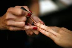 <p>A model has her nails painted backstage before the Jenni Kayne Fall/Winter 2011 collection show during New York Fashion Week February 10, 2011. REUTERS/Eric Thayer</p>