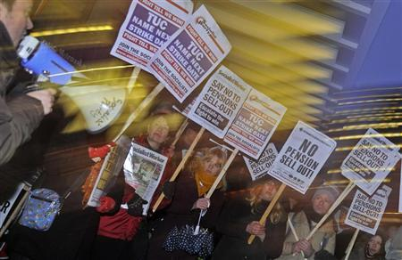 Demonstrators protest outside of the Trades Union Congress in central London December 19, 2011. REUTERS/Toby Melville